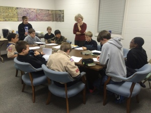 Scouts have begun working on their Citizenship in the Nation badge with Mrs. Myers.
